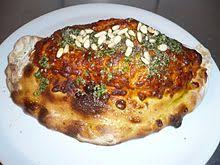 Calzone Topped With Tomato Sauce Cheese Pine Nuts And Pesto As Served In Theix France