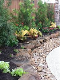 Rustic Flower Beds With Rocks In Front Of House Ideas