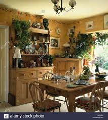 Small Pine Dresser And Dining Table In Yellow Room With Painted Border On The Wall