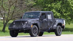 Jeep Wrangler Scrambler Pickup Caught In Motion On The Highway 2019 Jeep Pickup Jt Strips Some Camouflage Reveals Lights And Wrangler Truck Scrambler Toronto Missauga The Upcoming Finally Has A Name Autoguidecom News Caught In Motion On Highway Long Illtrious History Of Trucks Top Speed Protype First Sight 2018 Is Coming In Maxim Hitting Showrooms April 20 Gladiator Vs Pickup Trucks From Chevy Ford Nissan 1978 J20 Off Road Truck Renderings Best Look At New La Auto Show Is Unveiled As New Suv