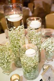 Simple Babys Breath In Cylinder Vases With Floating Candles Is An Elegant Touch To A Rustic Wedding Centerpieces