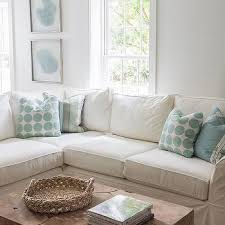 White Sectional With Aqua Blue Pillows