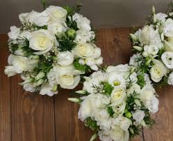 All white bridal bouquet Including Roses Lisianthus freesia & Wax