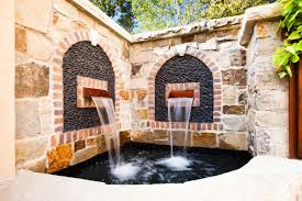 Spanish Wall Fountains Deisgn With Black Stone Decoratioin On Small Outdoor Ponds Full