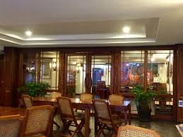 Lao Orchid Hotel Elegant Rattan And Teak Furniture Give A Nice French Colonial Feel