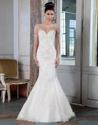 Justin Alexander Signature Wedding Dresses Style 9817 This Illusion Sabrina Neckline Fit And Flare Gown Features