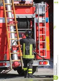 Firefighters In Action Take The Ladder From The Fire Engine Stock ... Fire Truck Action Stock Photos Images Alamy Toyze Engine Toy For Kids With Lights And Real Sounds Trucks In Triple Threat Combination Skeeter Brush Iaff Local 2665 Takes Legal Action To Overturn U City Contract 14 Red Engines Farmers Fileokosh Striker Fire Rescue Vehicle In Actionjpg Wikimedia In Pictures Prosters Burn Trucks Close N3 Highway Okosh 21 Stations Captain Jacks Brigade