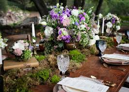 Outdoor Rustic Wedding Centerpieces Purple Flowers With Moss On Top Of Books