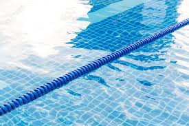 Blue Color Plastic Swimming Pool Lane Rope Floating On Water Surface Stock Photo
