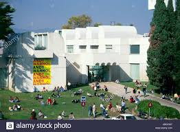 100 The Lawns Visitors Relax On The Lawns In Front Of The White Building