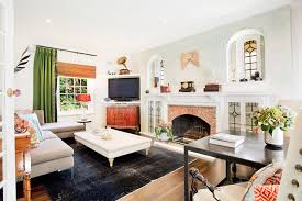 Example Of An Eclectic Enclosed Medium Tone Wood Floor Living Room Design In Los Angeles With