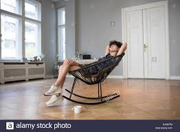 Young Woman Relaxing On Rocking Chair At Home Stock Photo ... Mid Century Rocking Chair Retro Modern Fabric Upholstered Wooden Chairs Style Armchair Relax Sleep Vner Panton Licensed Reproduction Relax Lounge Rocking Chair For Matzform Hot Item Cy2273 Top Quality Antique Relaxing Seller View Bodian Product Details From Bazhou City Bodian Fniture Co Ltd On Alibacom Sobuy With Adjustable Footrest Side Bag Fst18dg Baby Babies Kids Cots Amazoncom Lixiong Outdoor Garden Eclecticosineu Caline Parc Homhum Grey Padded Seat Rocker Nursery Comfortable Glider