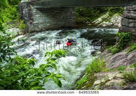 kayak rider makes drop into whitewater stock photo 649533088