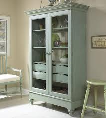 An Angular Display Cabinet With Glass Doors