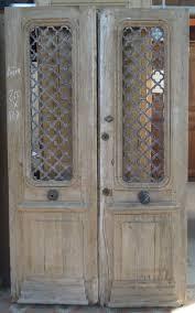 porte entree vantaux porte d entrée ancienne deux vantaux en chêne avec grilles fer forgé