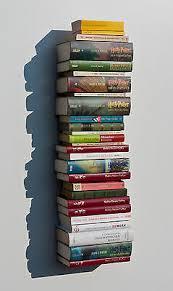 flying books bücherturm systemregal loft wohnzimmer