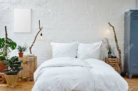 104 Urban Loft Interior Design Creative White Bed And Vivid Plants Stock Photo Picture And Royalty Free Image Image 80436242