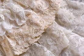 Closeup Of White Beige And Ivory Vintage Lace Fabrics Via Shutterstock