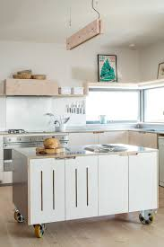 A Stainless Steel Surface And Large Industrial Wheels On The Bottom Of This Simple Movable Kitchen Island Give It An Look While Still Keeping