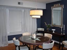 Navy Dining Room With Glass Topped Table