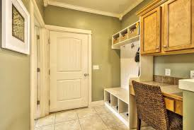 traditional mud room with limestone tile floors specialty door