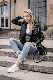 casual saturday style blue jeans white sneakers and black