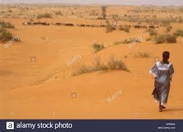 Woman Walking In Sahara Desert Burkina Faso West Africa