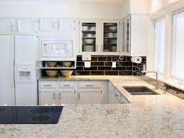kitchens with dark cabinets and white appliances dark brown