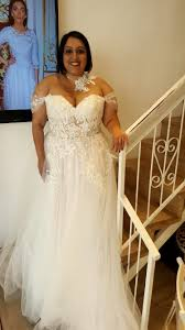 Real plus size bride in a corset strapless ball wedding gown with