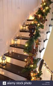 Lanterns And Christmas Garlands Adorn A Wooden Staircase And ... Christmas Decorating Ideas For Porch Railings Rainforest Islands Christmas Garlands With Lights For Stairs Happy Holidays Banister Garland Staircase Idea Via The Diy Village Decorations Beautiful Using Red And Decor You Adore Mantels Vignettesa Quick Way To Add 25 Unique Garland Stairs On Pinterest Holiday Baby Nursery Inspiring The Stockings Were Hung Part Staircase 10 Best Ideas Design My Cozy Home Tour Kelly Elko