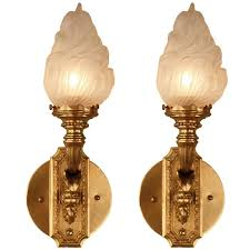 pair of bronze torch glass wall sconces at 1stdibs