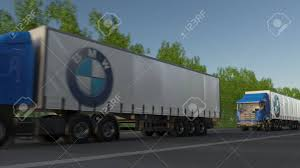 Freight Semi Trucks With BMW Logo Driving Along Forest Road ... Electric Trucks For Bmw Group Plant Munich Alex Miedema Family Trucks Vans Bmws Awesome M3 Pickup Truck Packs 420hp And Close To 1000 2015 Mustang Challenger Hellcat Bentley Coinental Gt M4 Used 2000 323i Parts Cars Pick N Save The Full Scoop On April Fools Car Driver Blog A X5based Actually Look Ok Caropscom X6 Euro Simulator 2 Download Ets Mods E92 Pickup Truck 2014 X5 First Trend 2011 Activehybrid Price Photos Reviews Features