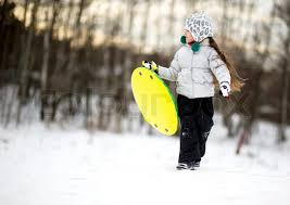 Cute Little Girl In Warm Clothes Running The Snow With Saucer Her Hands