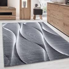 teppich modern designer wohnzimmer wellen holzoptik muster schwarz grau weiß