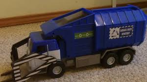 Blue Tonka Garbage Truck Empties Container - YouTube