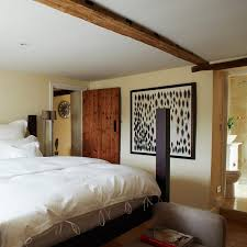 25BH Nov 17 P111 Rustic Neutral Bedroom With Four Poster Bed