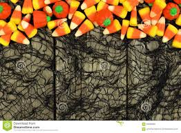 Top Halloween Candy 2017 halloween candy border against a wood and black cloth background