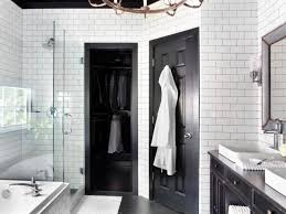 black and white bathroom with subway tile walls classic white