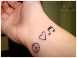 Love Music Peace Tattoo On Wrist