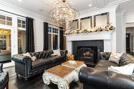 tufted leather sofa living room transitional with white fireplace