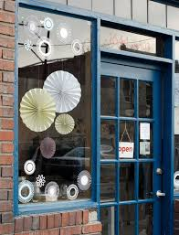 Simple Spring A And Inexpensive Way To Draw Attention Your Like Window Display Is Simply Hang Accordion Fold Tissue Paper Flowers Or