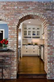 interior brick wall kitchen traditional with beige subway tile