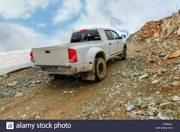 100 Rocky Mountain Truck Driving School A White Car With A Body Rides Up A Stony Road To The Top Of A