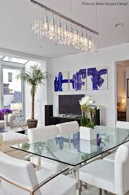 Contemporary Dining Room With An Elegant And Modern Feel Thanks To The White Furniture Blue