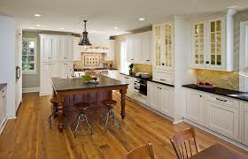 Big Square Wooden Table And Round Dining Stools Also Porcelain Floor Near White Kitchen Cabinet Plus