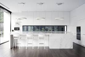 Handleless White Kitchen Cabinet With Beautiful Black Backsplas Also Low Back Barstool And Stylish Hanging Pendant Light Besides