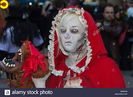 Greenwich Village Halloween Parade by Woman Dressed As Little Red Riding Hood Holding A Wolf U0027s Severed