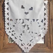 rideau brise bise triangle blanc coeurs et fleurs ajourés coton