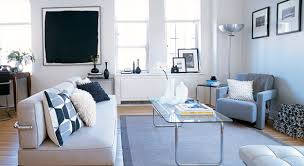Awesome Studio Decorations White Painted Walls Glass Table Top Black Framed Pictures Windows Off
