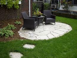 Inexpensive Patio Floor Ideas by Patio Stone Cheap Patio Floor Ideas With Black Rattan Chairs